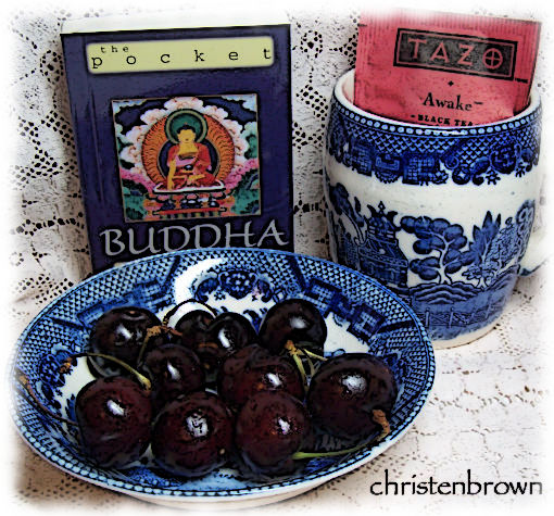 vintage tea cup and bowl of cherries